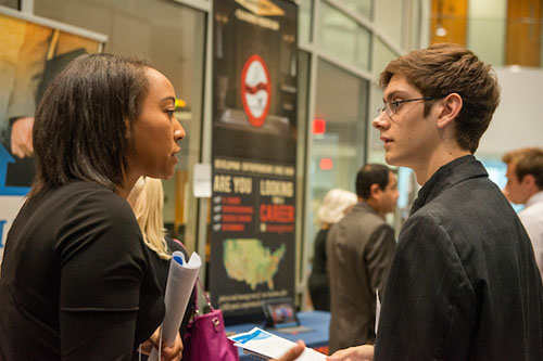 a male and female student talking at the 2015 CSB Career Event