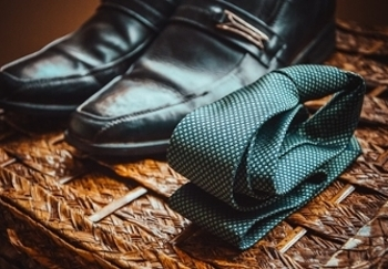 men's dress shoes and an emerald tie