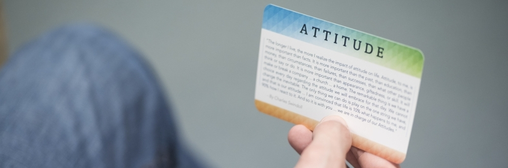 Student holding card about attitude