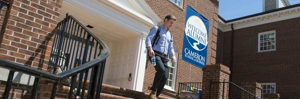 Student in front of Cameron Hall during Business Week