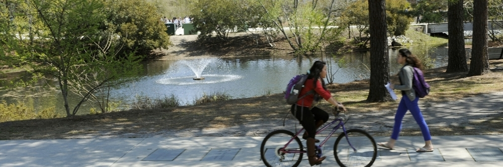 Students riding their bikes on campus
