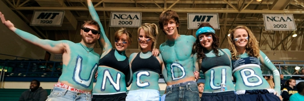 UNCW Students showing school spirit at a game