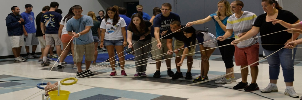 Student participating in a team building activity
